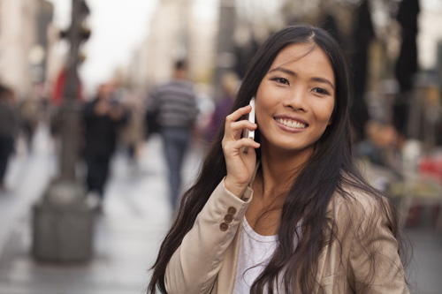 Filipino lady with phone in city